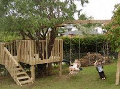 Free plans to build a Treehouse with a slide and swing set.