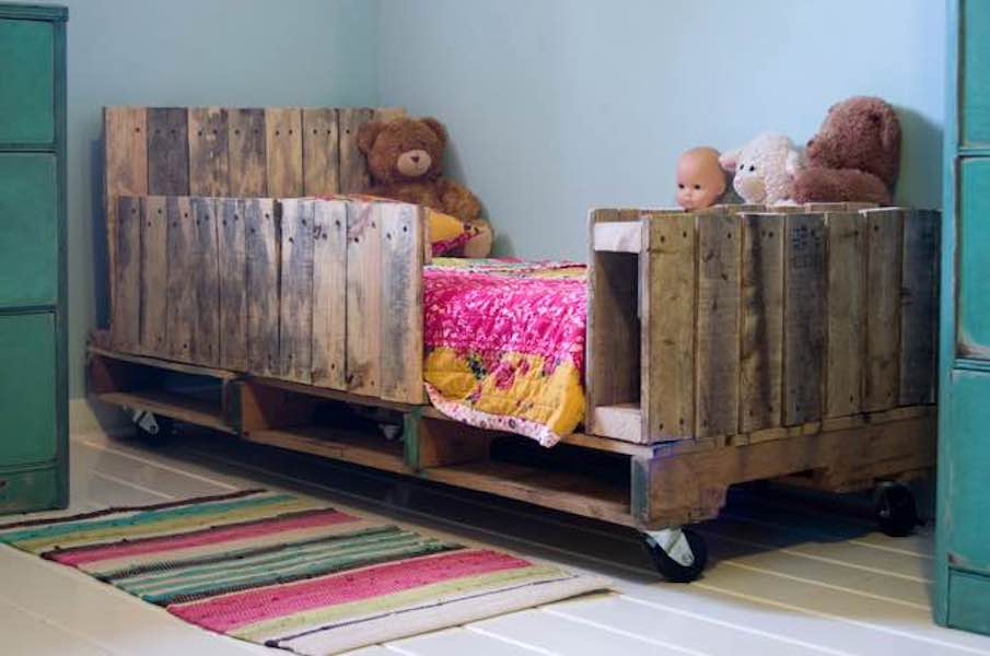 Build a Toddler Bed from Reclaimed Wood using free plans.