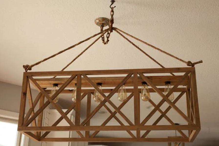 Free plans to build a Hanging Wooden X Chandelier.