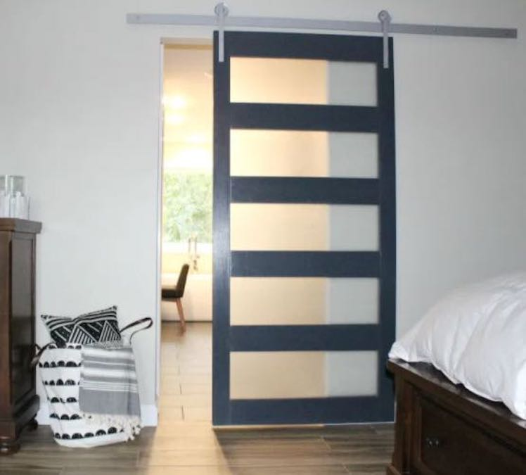 Build a Modern Sliding Barn Door using free plans.