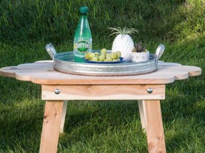 Free plans to build a Folding Adirondack Table.