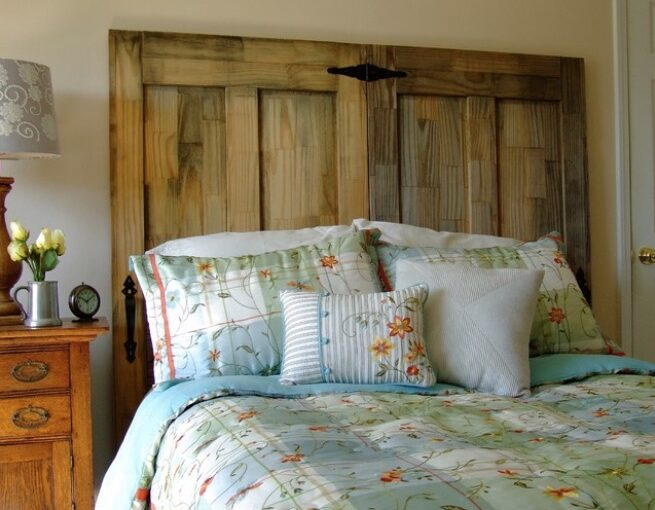 Build a bedroom headboard from salvaged doors.