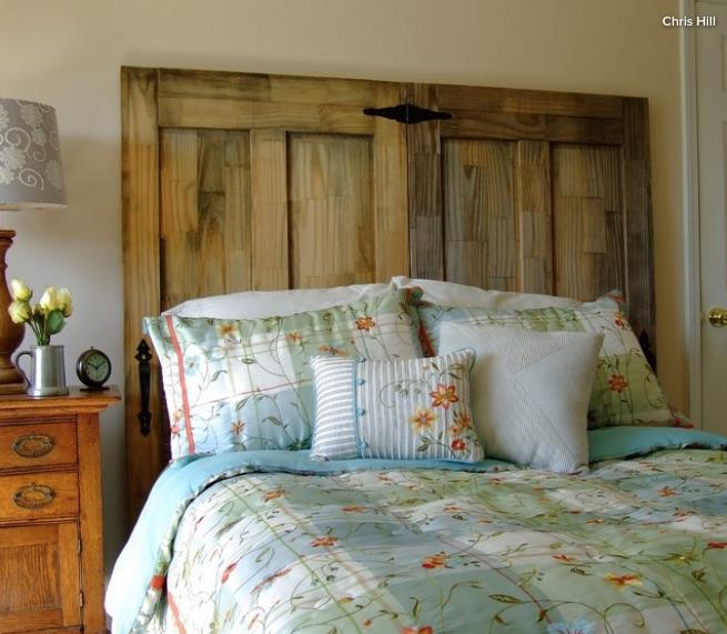 Build a bedroom headboard from salvaged doors.