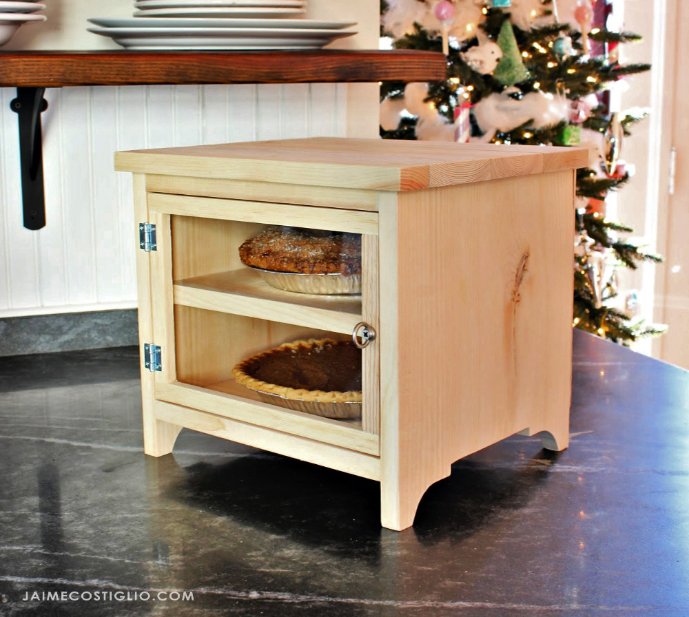 Free woodworking plans to build a countertop pie safe.