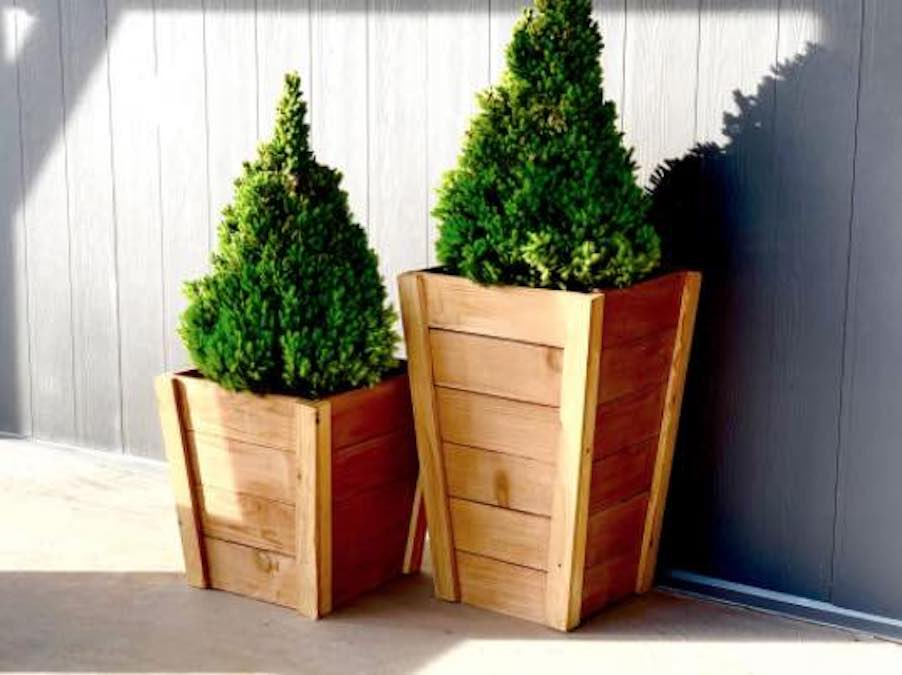 Build your own Tall Planters with free plans.