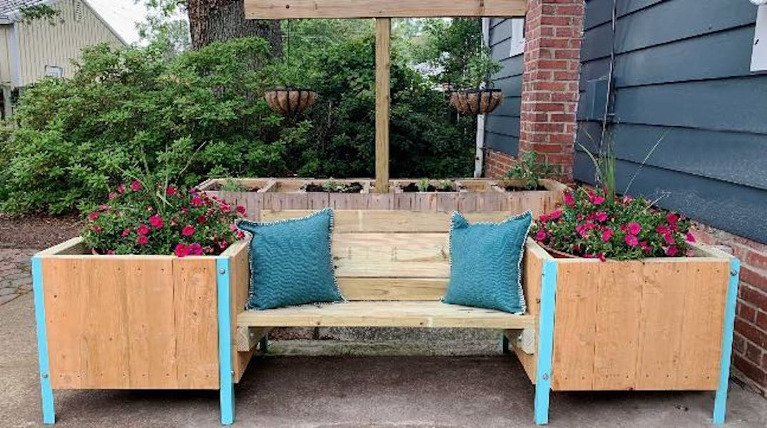 Free plans to build a Bench With Raised Planters.
