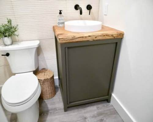 Build your own Bathroom Vanity Base with free plans.