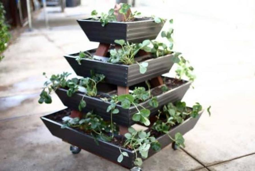Free plans to build a Pyramid Gutter Planter.