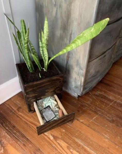 Build a Planter With Secret Drawer using free plans.