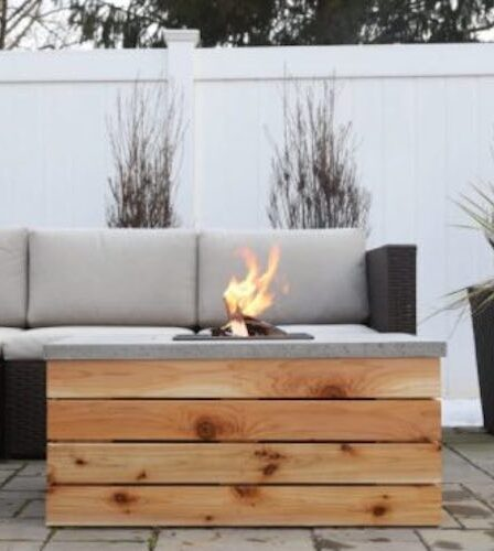 Free plans to build an Outdoor Coffee Table With Fire Pit Or Cooler.