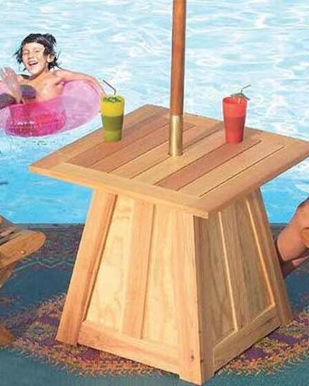Build an Patio Umbrella Stand And Table using free plans.