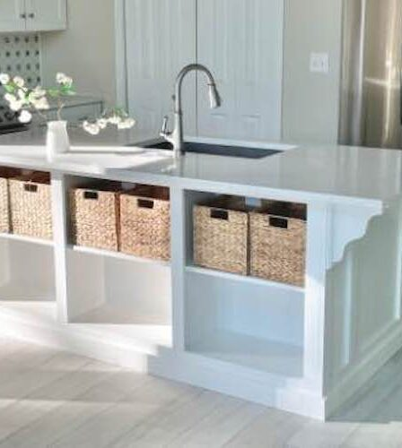 Build your own Kitchen Island With Open Shelving using free plans.