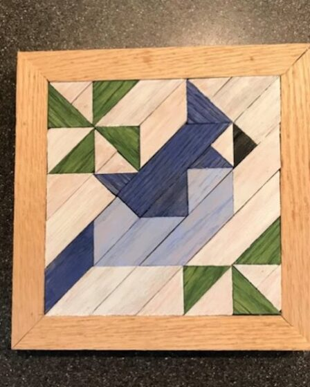 Make your own Blue Jay Barn Quilt Art with free plans.